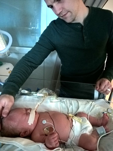 father with son in NICU