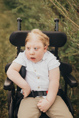 william outside in his wheelchair